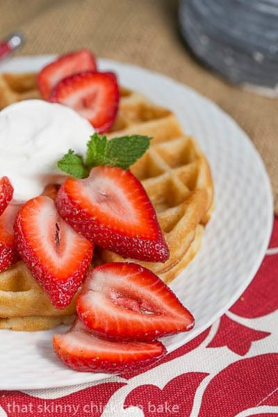 Close view of Belgian Waffles and Cream Dessert with sliced strawberries