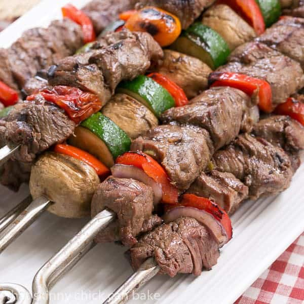 Beef Teriyaki Kabobs skewered on a white tray