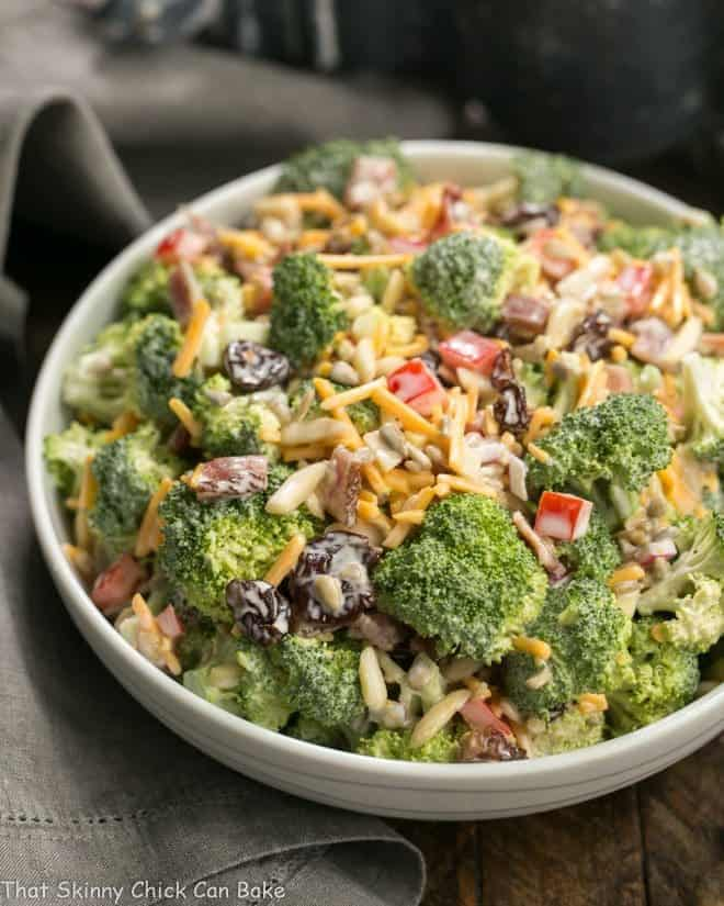White ceramic bowl filled with Broccoli Salad with Bacon and Dried Cherries
