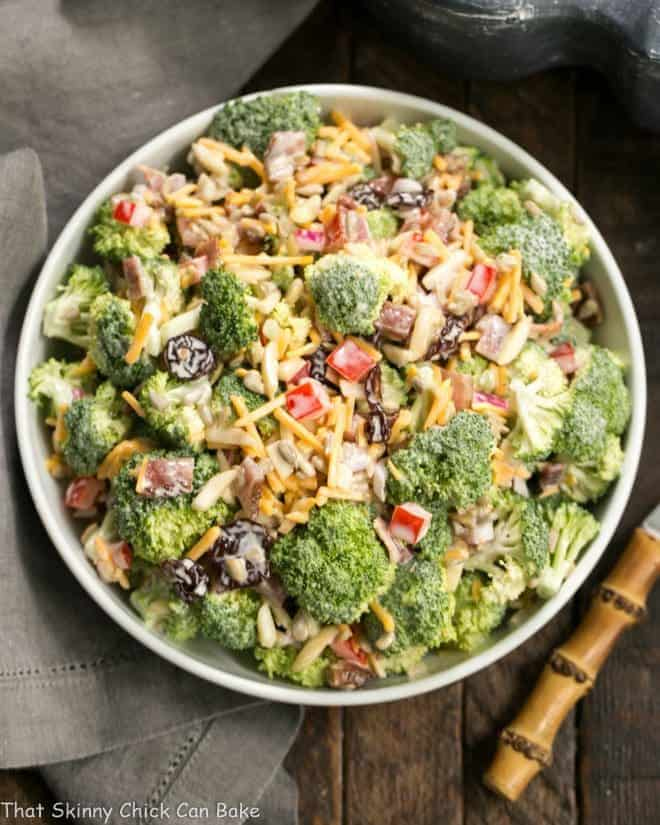 Overhead shot of Broccoli Salad with Bacon and Dried Cherries in a white serving bowl