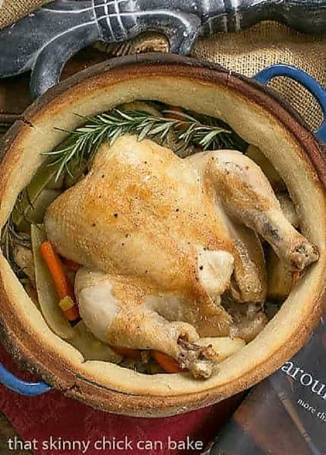 Chicken in a Pot from above cooked in a blue Dutch oven