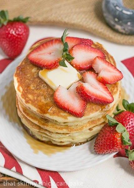 Classic Buttermilk Pancakes topped with strawberry slices viewed from above