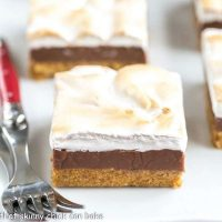 S'mores Fudge Bars   Graham cracker crust, fudgy center and marshmallow topping!