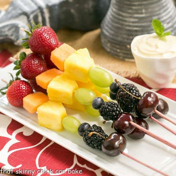 Fruit Kebabs with White Chocolate Mascarpone Dip on a white ceramic platter