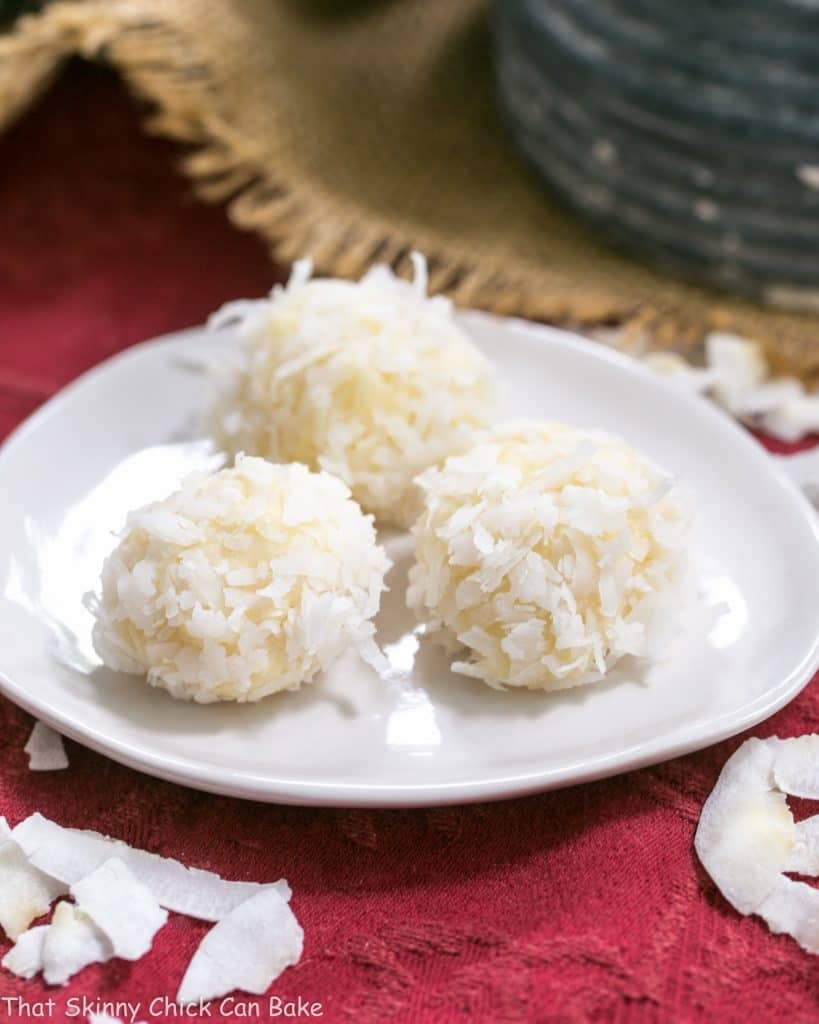Coconut White Chocolate Truffles - An easy, decadent 4 ingredient recipe! Perfect for gifts!