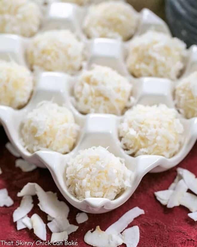 Close view of Coconut White Chocolate Truffles in a ceramic egg crate