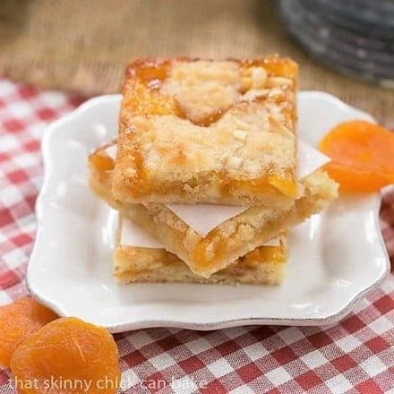 Coconut Apricot Bars stacked on a small white plate