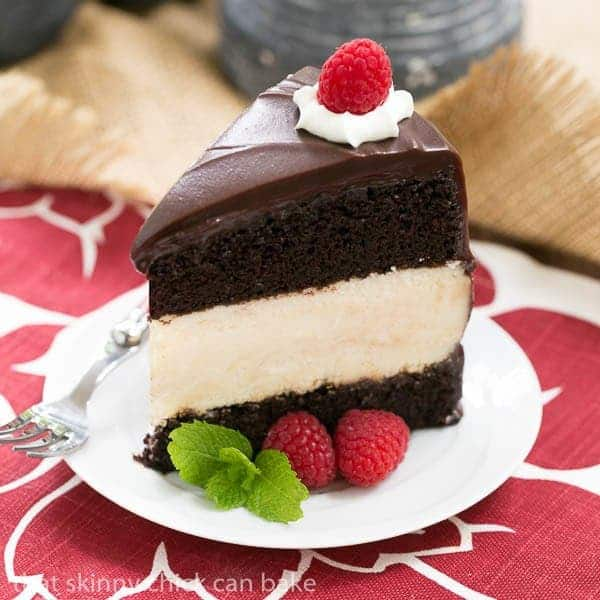 Moist buttermilk chocolate cake filled with a dreamy cheesecake and ...