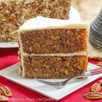 Classic Carrot Cake on a square white dessert plate with a red handled fork