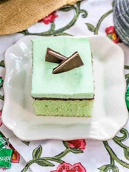 A slice of Creme de Menthe Cake garnished with Andes mints
