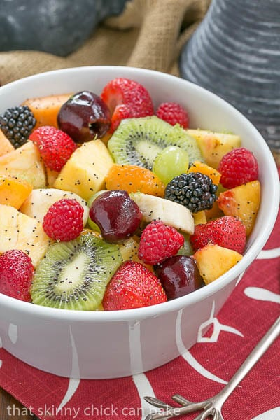 Close up view Honey Lime Fruit Salad in a white bowl