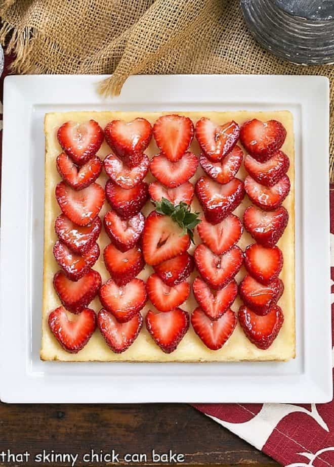 Strawberry Cheesecake Bars on a square white platter