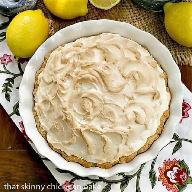 Mile High Lemon Meringue Pie in a white ceramic pie plate