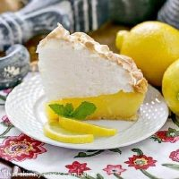 Slice of Mile High Lemon Meringue Pie on a white plate