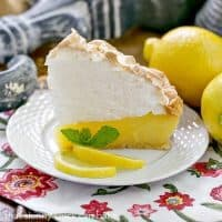 Mile High Lemon Meringue Pie - Luscious lemon filled pastry crust topped with a pillow of fluffy meringue
