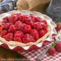 Simple Strawberry Pie |- Luscious ripe strawberries, a fresh berry glaze and a buttery pastry crust showcase this seasonal fruit