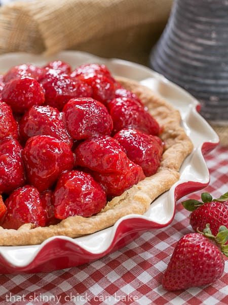Simple Strawberry Pie | Luscious ripe strawberries, a fresh berry glaze and a buttery pastry crust showcase this seasonal fruit
