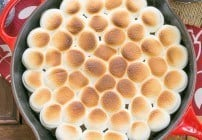 Skillet S'mores Dip | Chocolate ganache topped with roasted marshmallow with graham cracker dippers