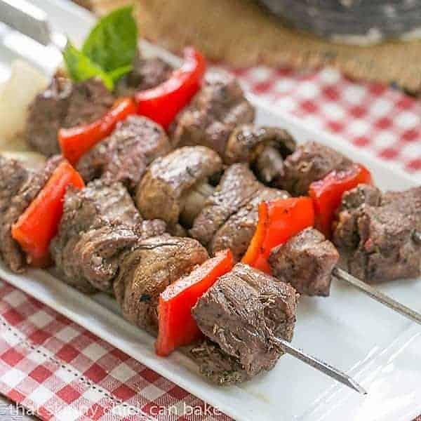 Tender Skewered Grilled Beef Steak Kabobs on a white tray