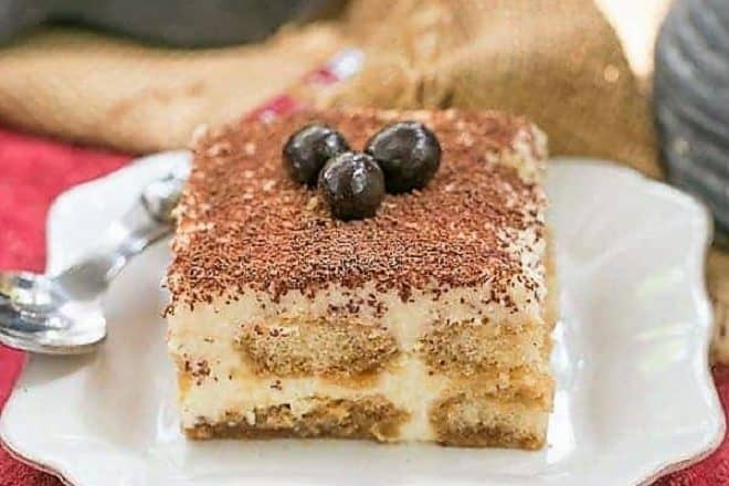 Slice of Classic Tiramisu on a square white plate