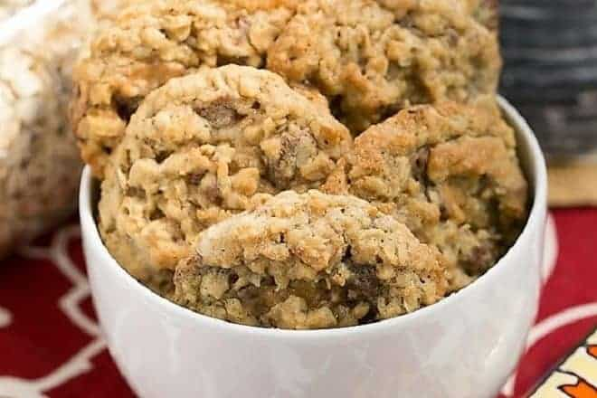 Chewy Oatmeal Toffee Cookies in a white ceramic bowl with Heath bars