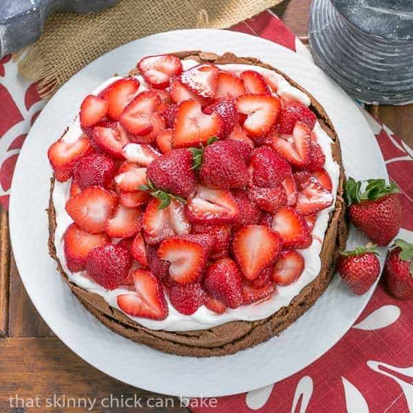 Chocolate Souffle Cake overhead shot with strawberries and cream