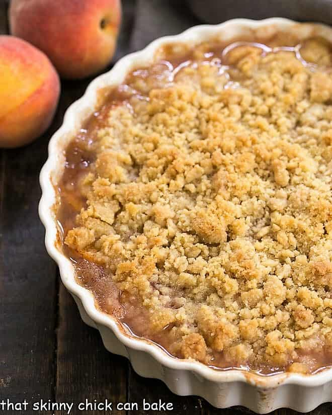 Classic Peach Crisp in a round scalloped casserole dish