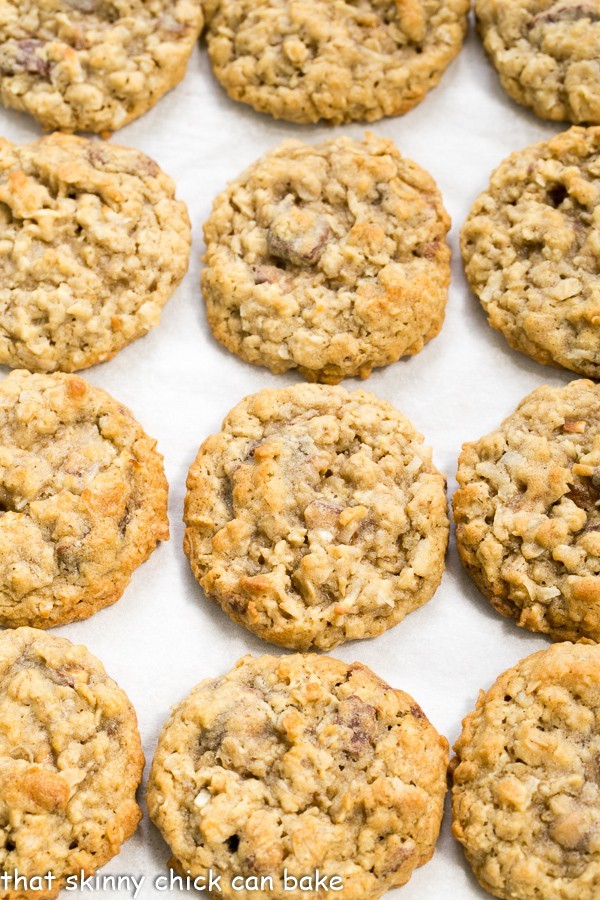 Chewy Oatmeal Toffee Cookies on a parchment lined baking sheet