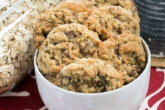 Chewy Oatmeal Toffee Cookies in a white bowl featured image