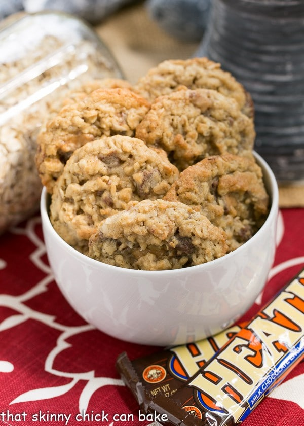 Chewy Oatmeal Toffee Cookies in a white bowl next to two Heath bars