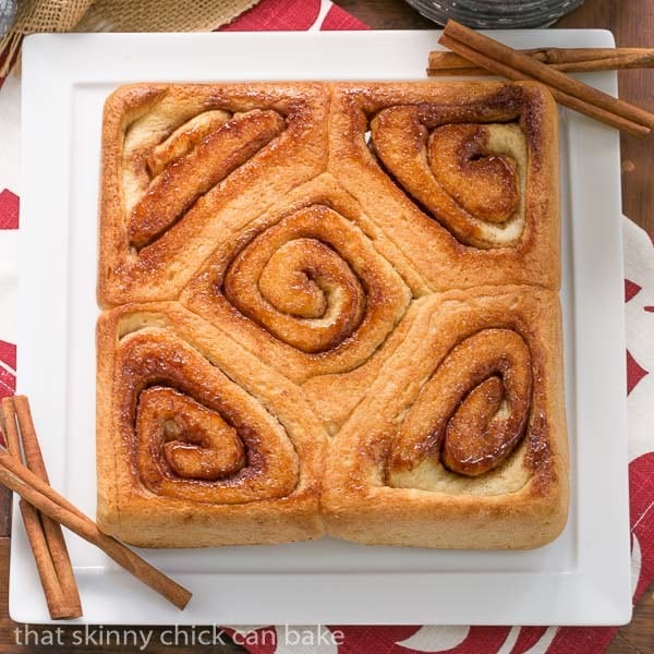 Unfrosted Old Fashioned Cinnamon Rolls on a square tray