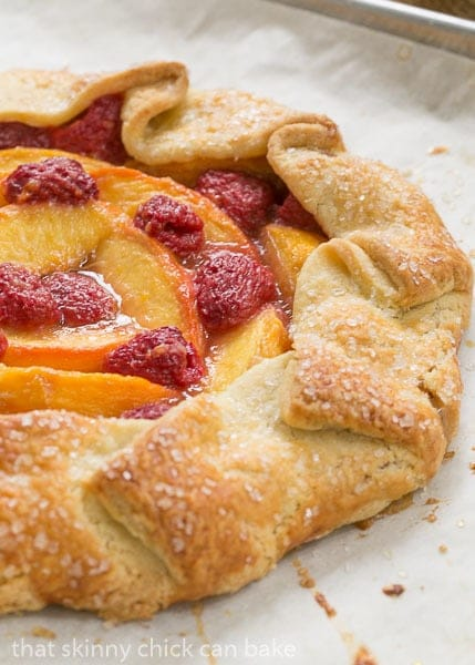 Peach Raspberry Galette on a parchment lined baking sheet