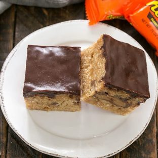 Two Stuffed Peanut Butter Rice Krispie Treats on a round white plate
