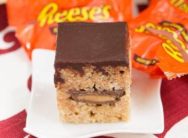 Stuffed Peanut Butter Rice Krispie Treats | A classic cereal treat stuffed with peanut butter cups!