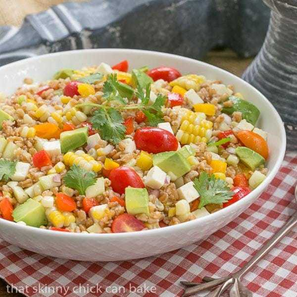 Summer Farro Salad | Farro, cukes, avocados, tomatoes and fresh corn dressed with a simple lime vinaigrette