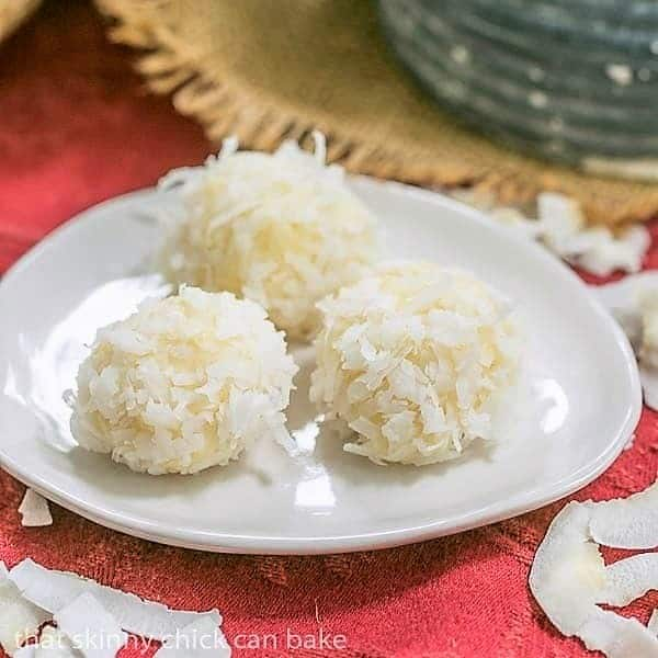 3 white chocolate coconut truffles on a small white plate