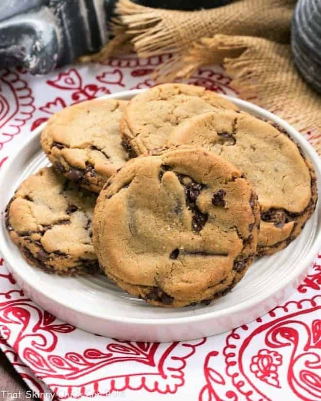 Layered Chocolate Chip Cookies on a white round plate