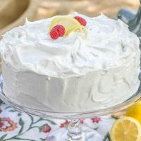 Lemon Layer Cake - 4 layers of vanilla cake filled with lemon curd and topped with a lemony Swiss meringue