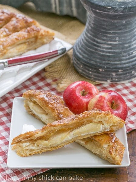 Maple Glazed Apple Tart slices on a square white ceramic plate