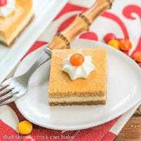 Pumpkin Cheesecake Bars on a small white plate
