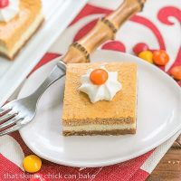 Pumpkin Cheesecake Bars - Biscoff crust topped with a layer of plain then pumpkin cheesecake!