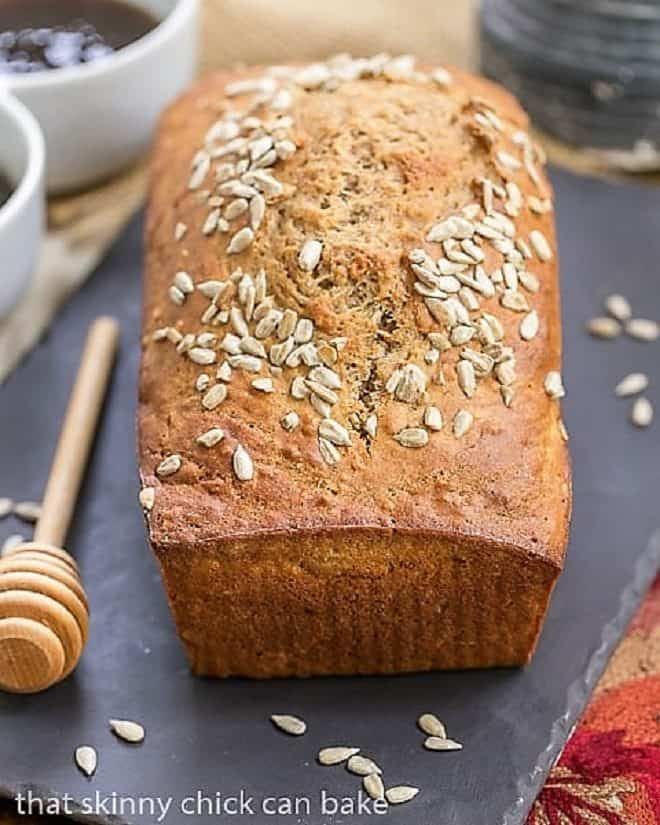 Loaf of Sunflower Whole Wheat Bread on a slate tray