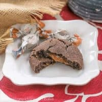 Caramel Filled Chocolate Cookies with oozing caramel revealed on a square white plate