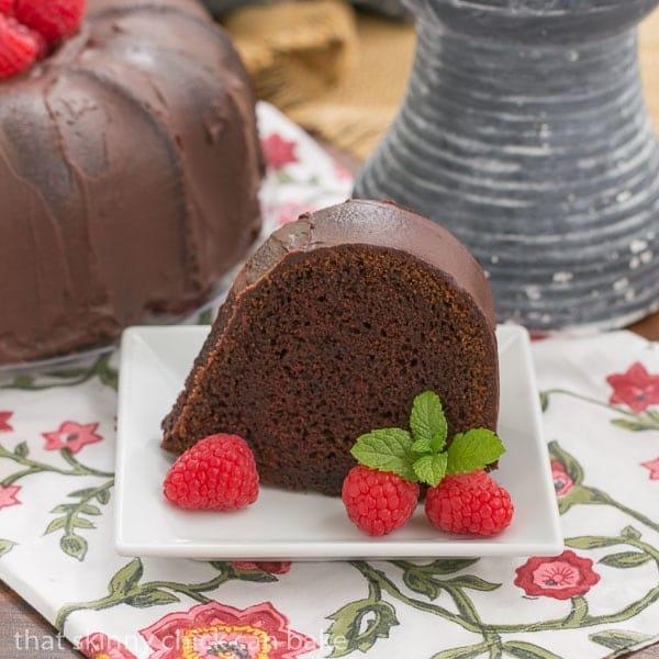 Slice of Chocolate Buttermilk Bundt Cake on a square white dessert plate