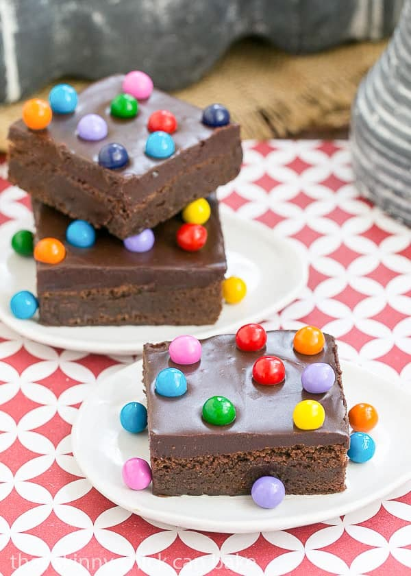 Cosmic Brownies | Fudgy brownies topped with ganache and chocolate filled candies!