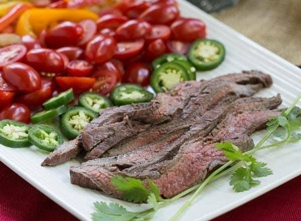 Flank Steak Fajitas   Marinated and grilled beef wrapped in a tortilla for an easy #WeekdaySupper
