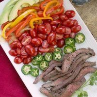 Flank Steak Fajitas - Marinated and grilled beef wrapped in a tortilla for an easy dinner