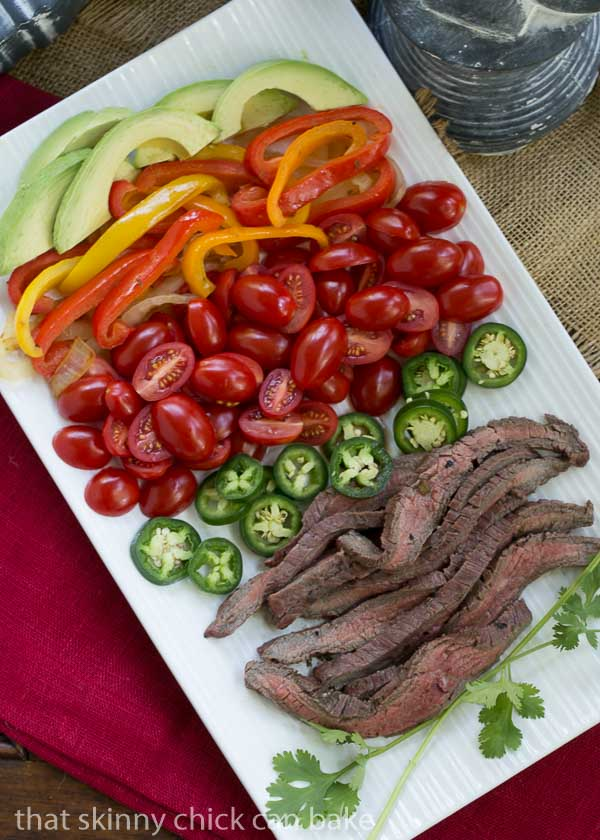 Flank Steak Fajitas | Marinated and grilled beef wrapped in a tortilla for an easy #WeekdaySupper
