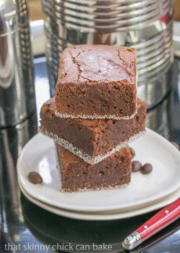Fudgy Mocha Brownies stacked on two oval white plates