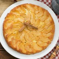 German Apple Pancake - Baked in a skillet with cinnamon apples and drizzled with cinnamon syrup